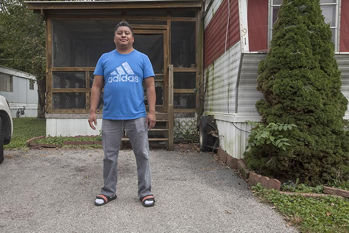 Noe Tellez, a restaurant owner in Iowa City, stands outside his home in Iowa City. (The Daily Iowan/ Jordan Gale)