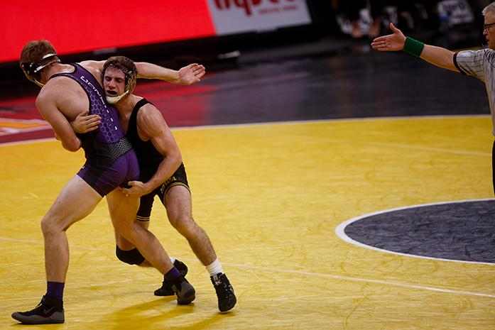 Iowas 185 pound Alex Meyer tries to take down Cornell Colleges Brian Cristion during the Iowa City Duals at the Carver-Hawkeye Arena, in Iowa City, Iowa  on Friday, Nov. 18, 2016. Iowa out wrestled both Cornell College 45-0 and Iowa Central College 55-0. (The Daily Iowan/Anthony Vazquez)