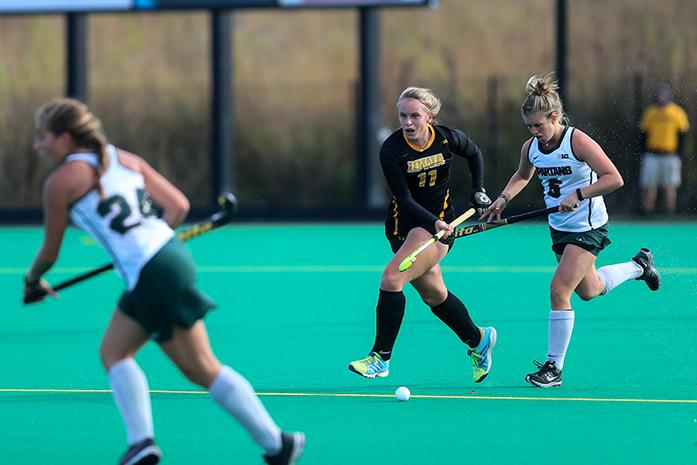 Iowa+midfielder+Katie+Birch+fends+off+Michigan+State+forward+Shelby+Spice+back+Caitlin+Abbot+during+the+Iowa+v.+Michigan+State+field+hockey+match+at+Grant+Field+on+Friday%2C+Oct.+21%2C+2016.+The+Hawkeyes+defeated+the+Spartans+5-3.+%28The+Daily+Iowan%2FAnthony+Vazquez%29
