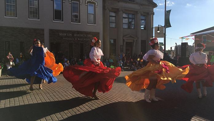 Women+dance+to+folkloric+Mexican+music+at+the+Latina+Fiesta+in+West+Liberty%2C+Iowa.+