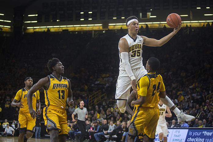 Iowa forward Cordell Pemsl attempts a shot over Kennesaw State guard Josh Burnett during a basketball game against Kennesaw State in Carver-Hawkeye Arena on Friday, Nov. 11, 2016. The Hawkeyes defeated the Owls, 91-74 in their season opener. (The Daily Iowan/Joseph Cress)