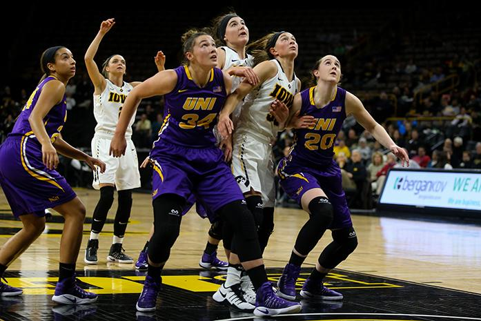 Hannah Schonhardt, Taylor Hagen of the Panthers and Megan Gustafson and Bre Cera of the Hawkeyes try to get possession of a rebound at the Carver-Hawkeye Arena on December 4,2016. The Hawkeyes defeated the Northern Iowa Panthers 88-39. (The Daily Iowan/Osama Khalid)