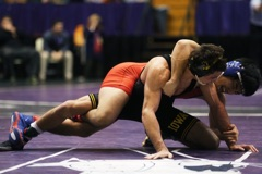 Iowa 125-pounder Thomas Gilman (black) wrestles Americans Josh Terao during the 54th Annual Ken Kraft Midlands Championships in Welsh-Ryan Arena on Friday, Dec. 30, 2016. Gilman defeated Terao by deacon, 8-6. Iowa won first place in the team completion with 150.5 points. (The Daily Iowan/Joshua Housing)