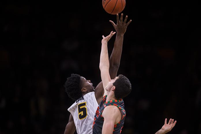 Iowa forward Tyler Cook tries to get control of the ball at the jump off during the Iowa v. Texas Rio Grande Valley basketball game at the Carver-Hawkeye Arena, in Iowa City, Iowa  on Sunday, Nov. 20, 2016. The Hawkeyes beat the Vaqueros 95-67.(The Daily Iowan/Anthony Vazquez)