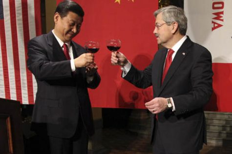 FILE - In this Feb. 15, 2012 file-pool photo, Chinese Vice President Xi Jinping and Iowa Gov. Terry Branstad raise their glasses at the beginning of a formal dinner in the rotunda at the Iowa Statehouse in Des Moines, Iowa. Branstad, President-elect Donald Trump