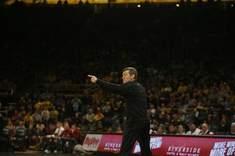 Iowa head coach Tom Brands points at the official during the Iowa-Iowa State match in Carver-Hawkeye Arena on Saturday, Dec. 10, 2016. Iowa defeated Iowa State, 26-9. (The Daily Iowan/Margaret Kispert)