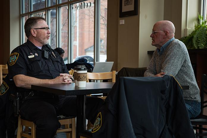 Officer R.A. Mebus sits down with City Council Member Jim Throgmorton, Council Member Throgmorton was working at High Ground and decided to take a break to speak to the officer, Coffee with a Cop is part of a monthly program that allows citizens sit down with police officers in an informal setting and ask questions or have a simple discussion. Coffee with a cop took place at High Grounds in Iowa City, Iowa on Nov. 30.(The Daily Iowan/Anthony Vazquez)