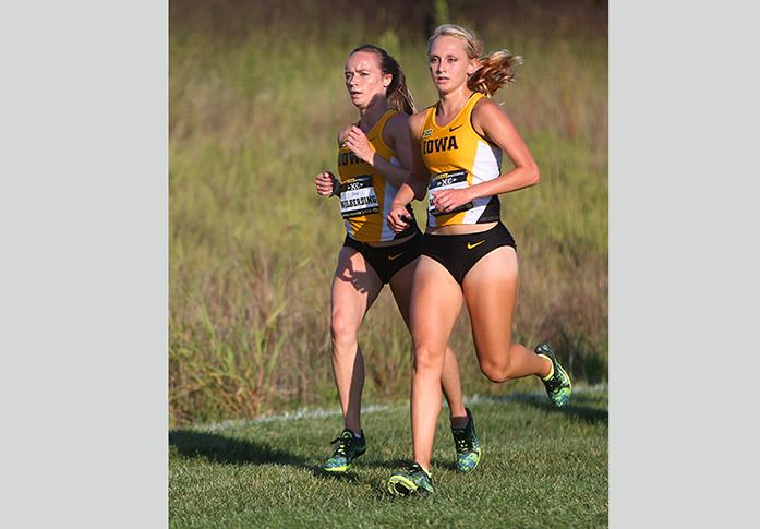 Iowa's Tess Wilberding and Madison Waymire run together during the women's 3K Hawkeye Earlybird Invitational at Ashton Cross Country on Friday, Sept. 2, 2016.