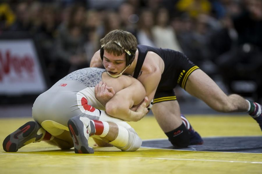 Iowas Brandon Sorensen holds down Ohio States Micah Jordan during the Iowa v. Ohio State Wrestling match, in Carver-Hawkeye Arena in Iowa City, Iowa  on Saturday, Jan. 27, 2017. The Hawkeyes beat the Buckeyes with a team score of 21-13. (The Daily Iowan/Anthony Vazquez)