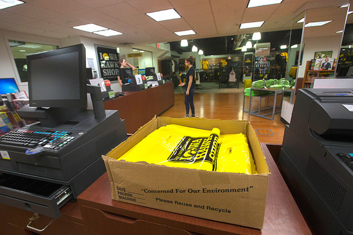 Iowa Hawk Shop bags sit on the counter of the store in the Iowa Memorial Union on Tuesday Feb. 28, 2017. The Hawk Shop wants to reusable bags in the store.