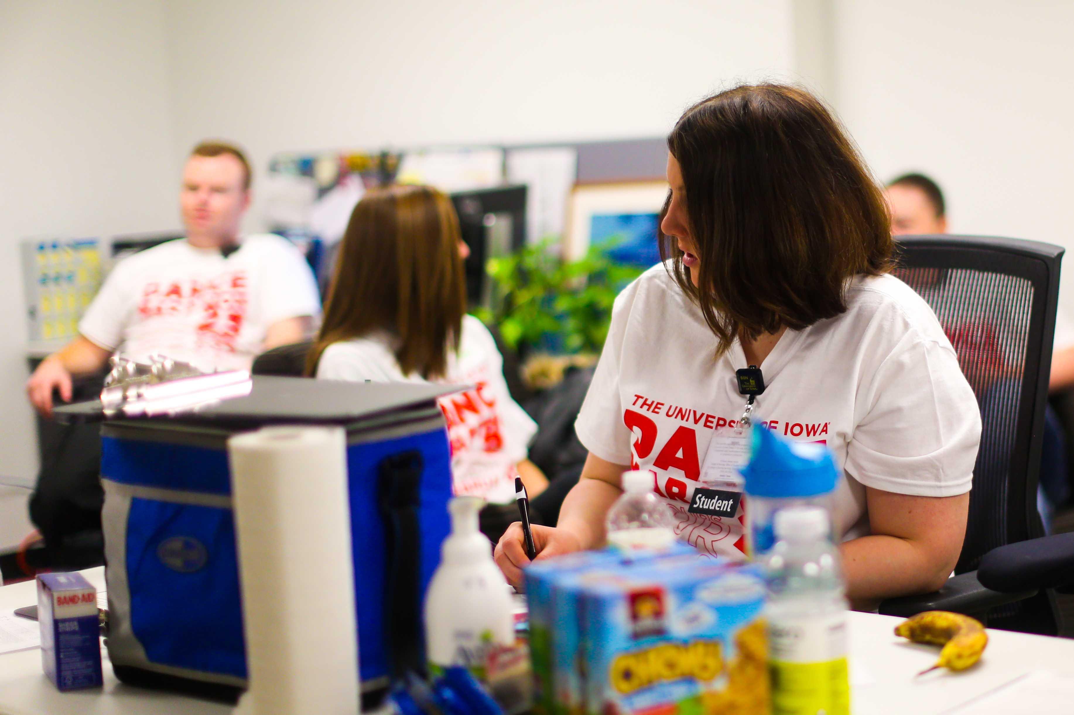 Amelia Jones, a UI freshman, volunteers as a first aid provider for Dance Marathon 23. (The Daily Iowan/Osama Khalid)