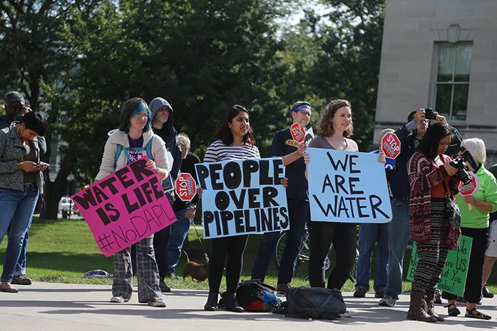 Locals participate in a peaceful protest regarding the Dakota Access Pipeline at the Pentacrest on Monday, October 10, 2016. The protest happened from 12:30-1:30 that contained an open mic allowing people to speak their opinions. (The Daily Iowan/ Alex Kroeze)