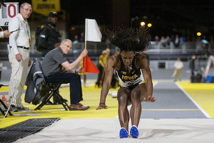 Jahisha Thomas lands in the sand in the long jump during the annual Black and Gold Intrasquad meet at UI Recreation Building, in Iowa City, Iowa  on Friday, Dec. 9, 2016. The track meet was the University of Iowas  christening of its new multi-million-dollar track.(The Daily Iowan/Anthony Vazquez)