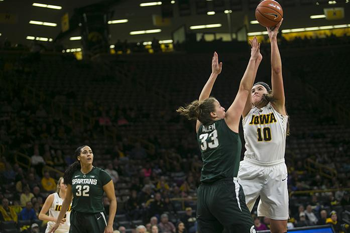 Iowa+center+Megan+Gustafson+takes+a+shot+over+Michigan+State+center+Jenna+Allen+during+a+women%27s+basketball+game+in+Carver-Hawkeye+Arena+on+Thursday%2C+Feb.+9%2C+2017.+Gustafson+averaged+a+double-double+and+led+the+team+in+points+%2818.5%29%2C+rebounds+%2810.1%29%2C+and+blocks+%281.3%29+while+starting+all+34+games+last+season.+%28The+Daily+Iowan%2FJoseph+Cress%29