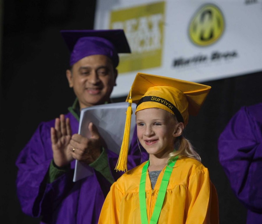 Dance+Marathon+kid+Jordyn+Gourley+receives+her+Graduation+Diploma+during+hour+20.+%28The+Daily+Iowan%2FAlex+Kroeze%29