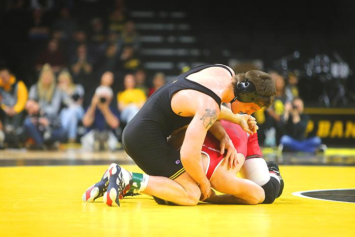 Iowas Sammy Brooks holds down Wisconsins Hunter Ritter during the Iowa v. Wisconsin wrestling bout, in Carver-Hawkeye  in Iowa City, Iowa  on Friday, Feb. 3, 2017. The Hawkeyes defeated the Badgers with a team overall of 33-8. (The Daily Iowan/Anthony Vazquez)