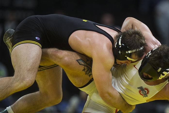 Iowas Steven Holloway takes down Ohio States Josh Fox during the Iowa v. Ohio State Wrestling match, in Carver-Hawkeye Arena in Iowa City, Iowa on Friday, Jan. 27, 2017. The Hawkeyes beat the Buckeyes with a team score of 21-13. (The Daily Iowan/Anthony Vazquez)