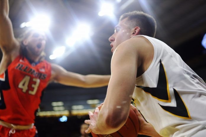 Iowa guard Jordan Bohannon inbounds a ball during a game against Illinois in Carver-Hawkeye Arena on Saturday, Feb. 18, 2017. Illinois defeated the Hawkeyes, 70-66. (The Daily Iowan/Josh Housing)