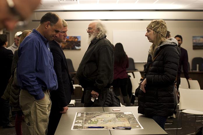 Residents examine a map during the Johnson County Poor Farm Master Plan on Wednesday, Mar. 1, 2017, in the Johnson County Health and Human Services building. In 1855, the Poor Farm Area was used as an asylum. (The Daily Iowan/Kenny Sim)
