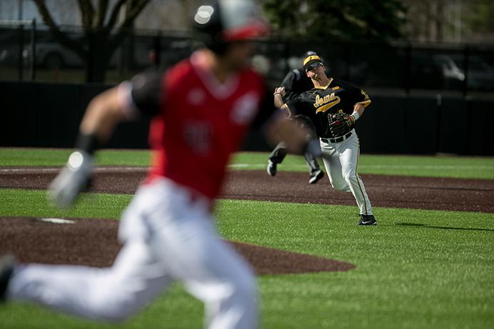 Iowa infielder Mitchell Boe throws the ball to first base during the Iowa vs. Northen Illinois baseball game at Duane Banks Field in Iowa City, Iowa on Tuesday, March 7, 2017. The Hawkeyes beat the Huskies 12-8. (The Daily Iowan/Anthony Vazquez)