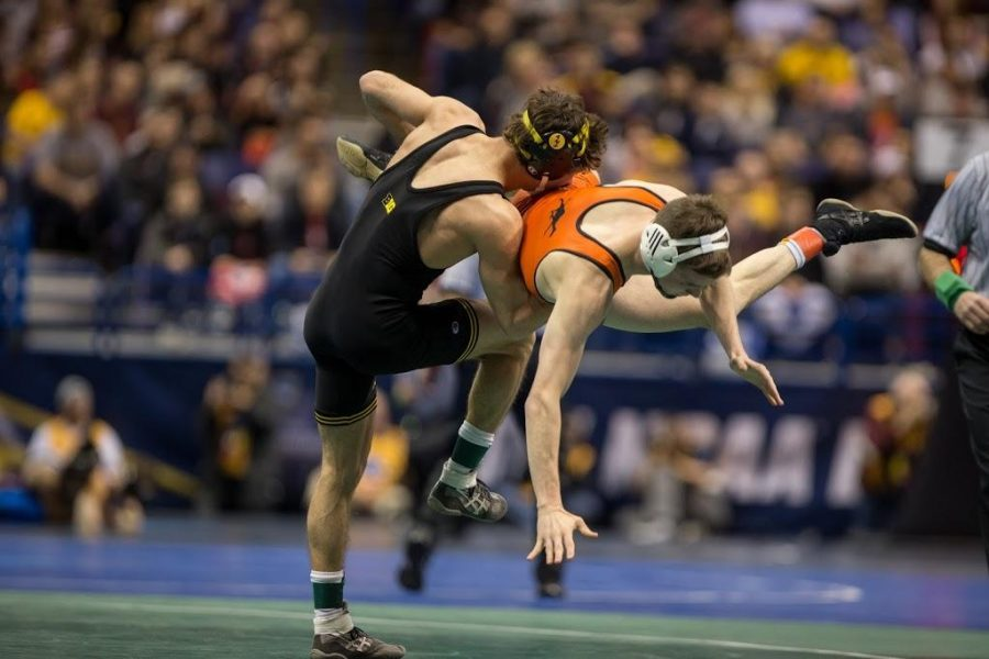 Iowa%E2%80%99s+Thomas+Gilman+lifts+Campbell%27s+Nathan+Kraisser+during+the+2017+NCAA+Division+I+Wrestling+Championships+in+the+Scottrade+Center+in+St.+Louis%2C+Missouri+on+Thursday%2C+March+16%2C+2017.+330+college+wrestlers+from+around+the+country+compete+to+named+the+national+champion+in+their+weight+class.+%28The+Daily+Iowan%2FAnthony+Vazquez%29