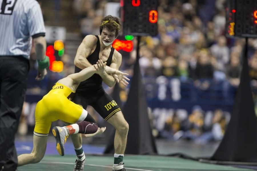 Iowa's Thomas Gilman pulls down Central Michigans Brent Fleetwood during the 2017 NCAA Division I Wrestling Championships in the Scottrade Center in St. Louis, Missouri on Thursday, March 16, 2017. 330 college wrestlers from around the country compete to named the national champion in their weight class. (The Daily Iowan/Anthony Vazquez)