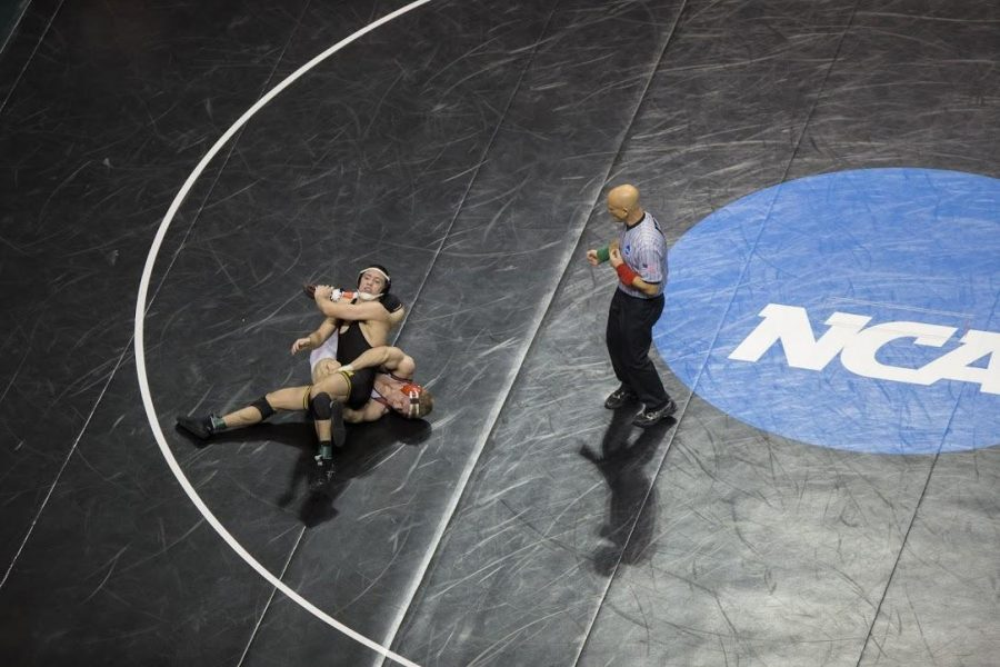 Iowa's Michael Kemerer tries to maintain control of Indianas Jake Danishek during the 2017 NCAA Division I Wrestling Championships in the Scottrade Center in St. Louis, Missouri on Thursday, March 16, 2017. 330 college wrestlers from around the country compete to named the national champion in their weight class. (The Daily Iowan/Anthony Vazquez)