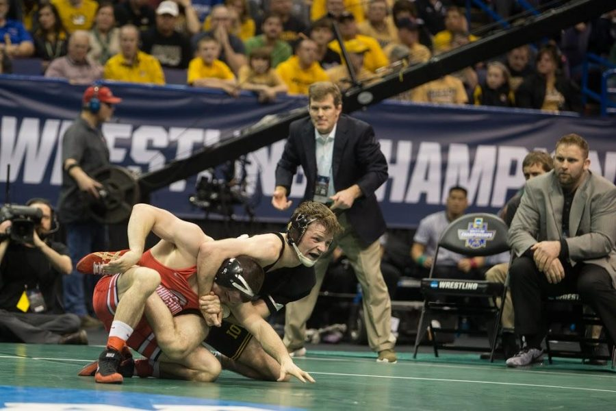Iowa%27s+Cory+Clark+holds+onto+Ohio+State%27s+Nathan+Tomasello+during+the+2017+NCAA+Division+I+Wrestling+Championships+in+the+Scottrade+Center+in+St.+Louis%2C+Missouri+on+Friday%2C+March+17%2C+2017.+Day+two+of+the+National+Championships+shrinks+the+number+of+competitors+down+to+the+final+competition+for+the+Championship+match+on+Saturday.+%28The+Daily+Iowan%2FAnthony+Vazquez%29