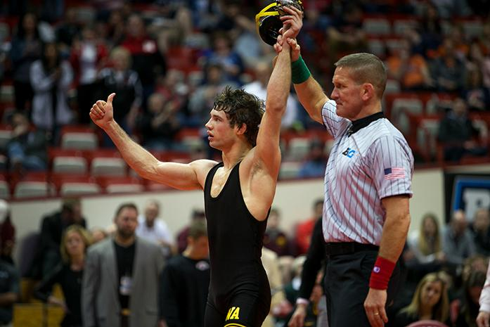 Iowa's Thomas Gilman has his hand raised in victory during the Big Ten Wrestling Championships in the Simon Skjodt Assembly Hall in Bloomington, Indiana on Sunday, March 5, 2017. There were upsets, close calls, and dominant performances at the Big Ten Tournament. Ohio State was named the Big Ten Champion at the end of the two day event.(The Daily Iowan/Anthony Vazquez)