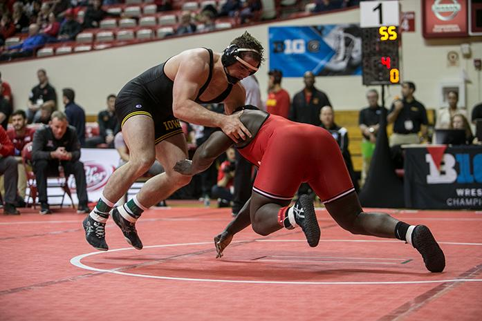 Iowas Steven Holloway avoids a takedown from Rutgers Razohnn Gross during the Big Ten Wrestling Championships in the Simon Skjodt Assembly Hall in Bloomington, Indiana on Saturday, March 4, 2017. Big Ten wrestlers compete for a chance to be named Big Ten Champion of their weight class.(The Daily Iowan/Anthony Vazquez)
