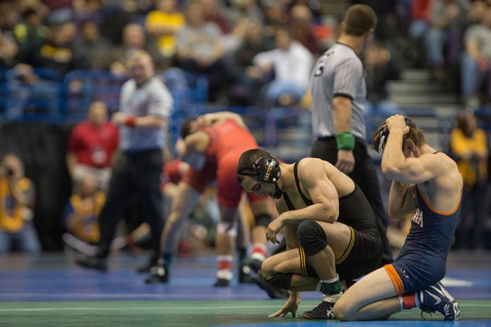 Iowa's Topher Carton is defeated by Virginias George DiCamillo during the 2017 NCAA Division I Wrestling Championships in the Scottrade Center in St. Louis, Missouri on Thursday, March 16, 2017. 330 college wrestlers from around the country compete to named the national champion in their weight class. (The Daily Iowan/Anthony Vazquez)