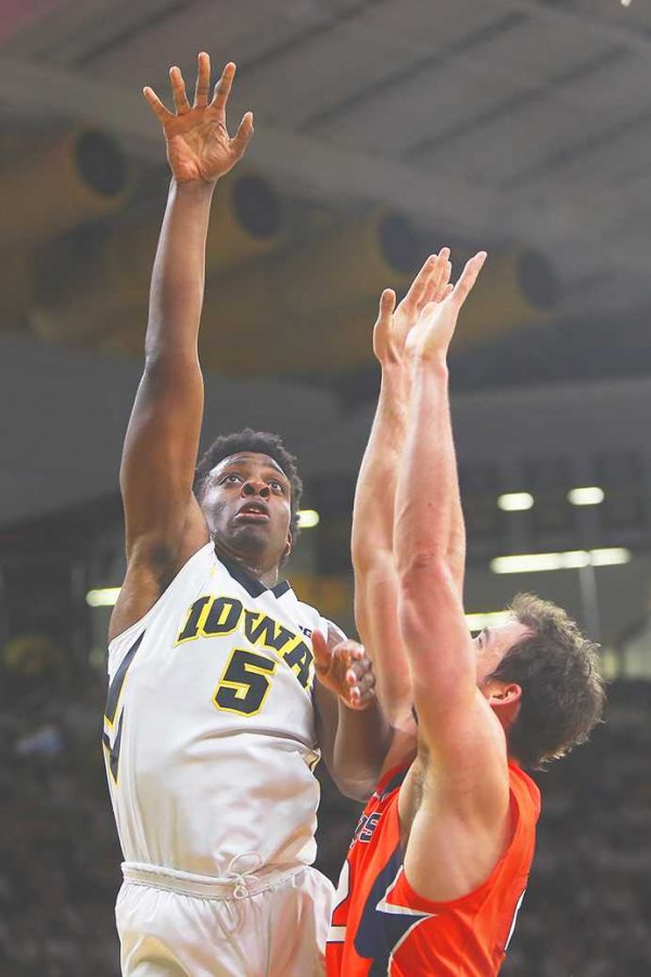 Iowa forward Tyler Cook scores off the post against Illinois on Saturday, Feb. 18, 2017 in Carver-Hawkeye Arena. Cook finished the game with 14 points and 3 rebounds. The Fighting Illini defeated the Hawkeyes, 70-66. (The Daily Iowan/Joshua Housing)