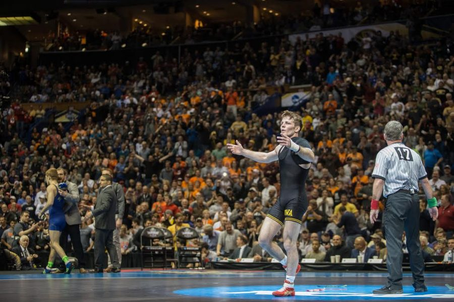 Iowa+133-pounder+Cory+Clark+celebrates+after+winning+the+final+match+at+the+NCAA+Championships+in+St.+Louis%2C+Missouri+on+Saturday%2C+March+18%2C+2017.+Clark+is+the+first+Hawkeye+to+win+the+title+since+Tony+Ramos+in+2014.+%28Anthony+Vazquez%2F+The+Daily+Iowan%29