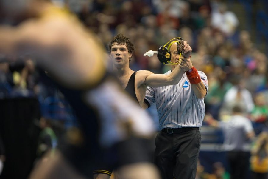Iowa%27s+Thomas+Gilman+has+his+hand+raised+and+moves+on+to+the+semifinals+during+the+2017+NCAA+Division+I+Wrestling+Championships+in+the+Scottrade+Center+in+St.+Louis%2C+Missouri+on+Friday%2C+March+17%2C+2017.+Day+two+of+the+National+Championships+shrinks+the+number+of+competitors+down+to+the+final+competition+for+the+championship+matches+on+Saturday.+%28The+Daily+Iowan%2FAnthony+Vazquez%29