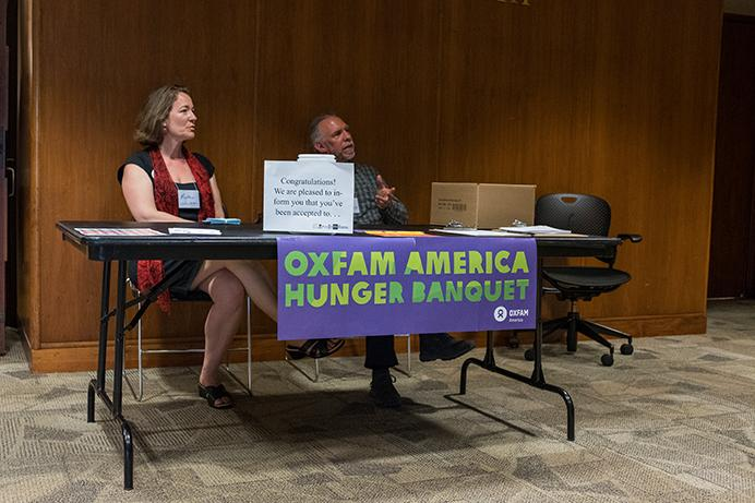 Volunteers man the table for students to grab certain tickets as part of the banquet  during the Oxfam America Hunger Banquet in Iowa Memorial Union in Iowa City, Iowa on Saturday, April 8, 2017. The Hunger Banquet discussed food shortages, food insecurity, and what students could do to help. (The Daily Iowan/Anthony Vazquez)