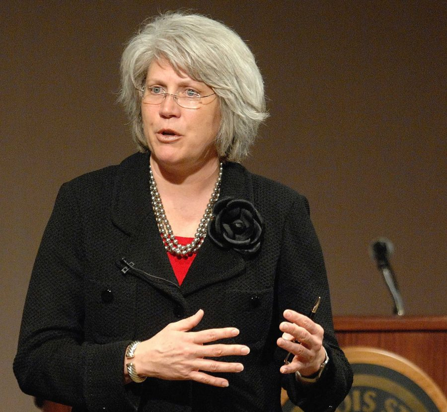In this April 18, 2011 photo, Jane Meyer, senior associate athletic director at the University of Iowa, speaks in Normal, Ill. Meyer, the former no. 2 administrator for Iowa athletics will square off against the school in a trial beginning Monday, April 17, 2017, that centers on her claim that she suffered discrimination as a gay female who fought bias in college sports. The trial in a lawsuit brought by Meyer is expected to litigate whether Athletic Director Gary Bartas personnel moves were tough-but necessary judgment calls or tainted by discrimination. (Lori Ann Cook-Neisler/The Pantagraph via AP)