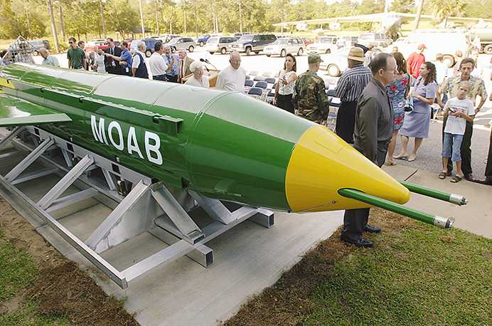 In this May 2004 photo, a group gathers around a GBU-43B, or massive ordnance air blast (MOAB) weapon, on display at the Air Force Armament Museum on Eglin Air Force Base near Valparaiso, Fla. U.S. forces in Afghanistan struck an Islamic State tunnel complex in eastern Afghanistan on Thursday, April 13, 2017, with a GBU-43B, the largest non-nuclear weapon ever used in combat by the U.S. military, Pentagon officials said. (Mark Kulaw/Northwest Florida Daily News via AP)