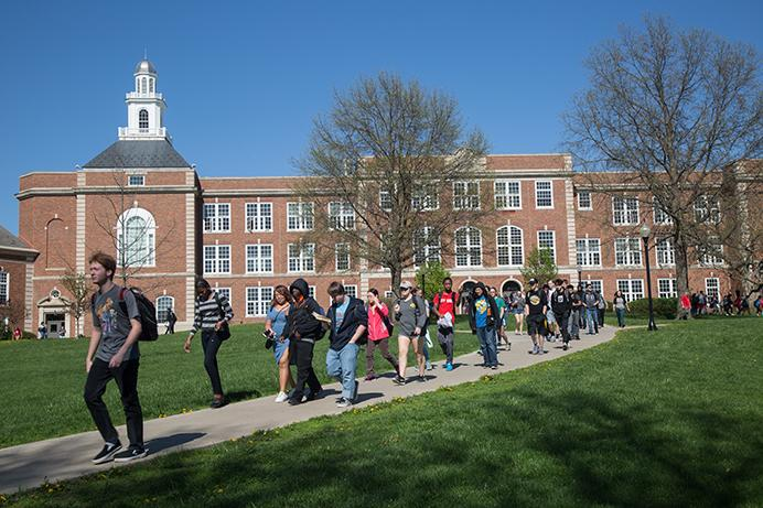 Students walk to the buses and their cars at the end of the school day at Iowa City High School in Iowa City, Iowa on Monday, April 17, 2017. Though graduation rates in Iowa reach 91.3 in the 2015-16 school year, dropout rates have increased from 2.5 to 2.8 percent for the first timein five years.(The Daily Iowan/Anthony Vazquez)