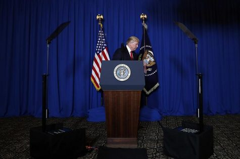 In this April 6, 2017, photo, President Donald Trump walks from the podium after speaking at Mar-a-Lago in Palm Beach, Fla., Thursday, April 6, 2017, after the U.S. fired a barrage of cruise missiles into Syria. Trump's White House, one perpetually plagued by infighting among aides jockeying for the president's ear, has been sharply divided by a new rivalry, one pitting his powerful son-in-law with unfettered access to the president against the sharp-elbowed ideologue who fueled Trump's populist campaign rhetoric. (AP Photo/Alex Brandon)