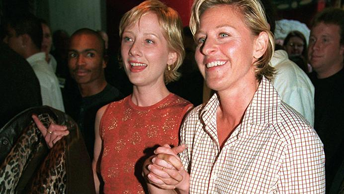 FILE - In this June 19, 1997 file photo, actress-comedian Ellen DeGeneres, right, and actress Anne Heche arrive at the world premiere of the film Face/Off, in the Hollywood section of Los Angeles. It was 20 years ago that Ellen DeGeneres made history as the first prime-time lead on network TV to come out of the closet. The episode of Ellen was watched by a staggering 44 million viewers. It won an Emmy for writing, a Peabody as a landmark in broadcasting and numerous other accolades(AP Photo/Chris Pizzello, File)