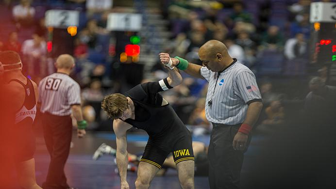Iowa's Cory Clark has his hand raised during the 2017 NCAA Division I Wrestling Championships in the Scottrade Center in St. Louis, Missouri on Thursday, March 16, 2017. 330 college wrestlers from around the country compete to named the national champion in their weight class. (The Daily Iowan/Anthony Vazquez)