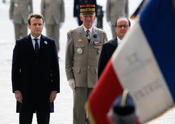 Current French President Francois Hollande and French president-elect Emmanuel Macron, left, participate in a ceremony to mark Victory Day in Paris, France, Monday, May 8, 2017. French president-elect Emmanuel Macron appeared Monday alongside current President Francois Hollande in commemoration of the end of World War II. Monday, a national holiday, marks the day of the formal German defeat in World War II. (AP Photo/Francois Mori, Pool)
