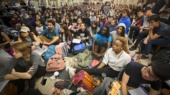 St. Olaf College students fill Tomson Hall to boycott classes and demand action and dialogue after numerous acts of incidents of racial hate on campus, Monday, May 1, 2017 in Northfield, Minn. Hundreds of students boycotted classes at St. Olaf College on Monday, instead packing an administration building to protest a rash of racist and threatening messages left around campus. (Elizabeth Flores/Star Tribune via AP)