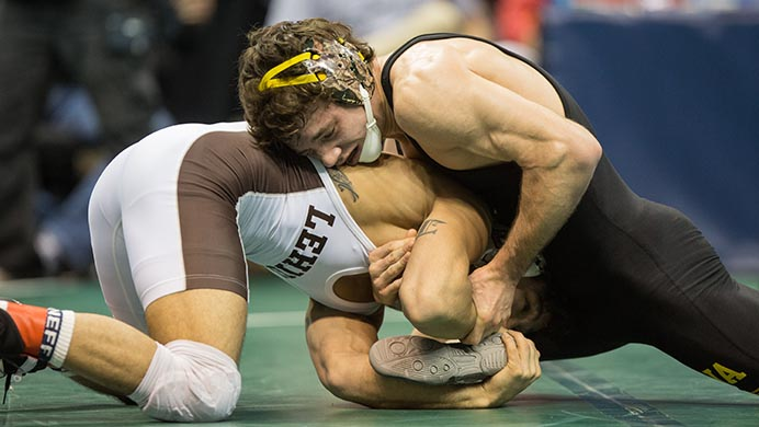Iowa's Thomas Gilman tries to hold off Lehighs Darian Cruz during the 2017 NCAA Division I Wrestling Championships in the Scottrade Center in St. Louis, Missouri on Friday, March 17, 2017. Day two of the National Championships shrinks the number of competitors down to the final competition for the Championship match on Saturday. (The Daily Iowan/Anthony Vazquez)