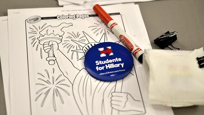 Supporters for Hillary draw with coloring pages and cookies for caucus participants on February, 1, 2016. (The Daily Iowan/File Photo)