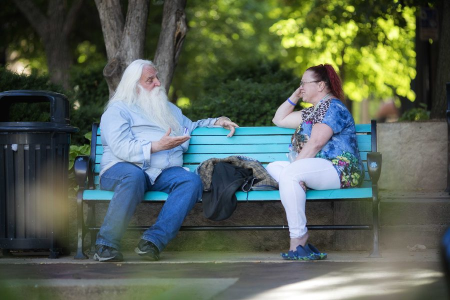 Audrey Buchman and her friend Bob get caught up in the Ped Mall on Monday, June 26, 2017. They both frequent the area and chat regularly. (James Year/The Daily Iowan)