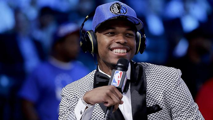 Dennis Smith Jr. answers questions during an interview after being selected by the Dallas Mavericks as the ninth pick overall during the NBA basketball draft, Thursday, June 22, 2017, in New York. (AP Photo/Frank Franklin II)
