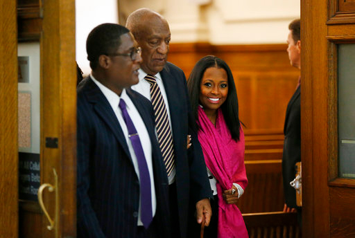 Actress Keshia Knight Pulliam, right, walks out of the courtroom with Bill Cosby, center, inside the Montgomery County Courthouse during his sexual assault trial in Norristown, Pa., Monday, June 5, 2017. Pulliam played Cosby's youngest daughter, Rudy Huxtable, on The Cosby Show. (David Maialetti/The Philadelphia Inquirer via AP, Pool)