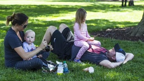 The Schlee Family is relaxing in the Pentacrest on Tuesday, June 27. The family visited Iowa City for the first time as they drove to Omaha, Nebraska from Michigan. (Hieu Nguyen/The Daily Iowan)