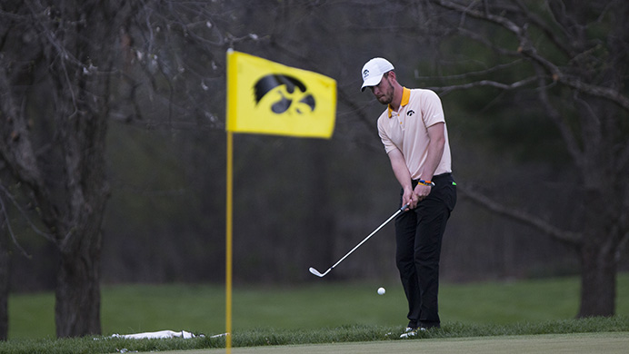 Iowa%27s+Raymond+Knoll+swings+onto+the+green+during+the+Hawkeye+Invitational+at+Finkbine+Golf+Course+on+Saturday%2C+April+15%2C+2017.+Iowa+currently+sits+in+third+after+one+and+a+half+rounds+in+the+tournament%2C+play+was+delayed+late+Saturday+afternoon+due+to+inclement+weather.+%28Joseph+Cress%2FThe+Daily+Iowan%29